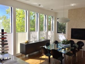 The bottom-up motorized roller shades are the perfect protection from glare in this kitchen.